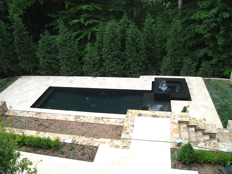 Private pool with travertine patio in Marvin, NC