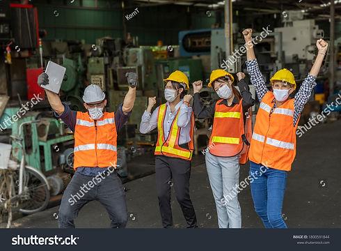 stock-photo-team-of-mechanic-engineers-w