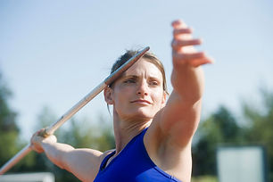 Women holding a javelin ready to throw