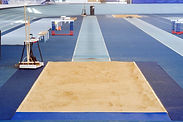 Image of indoor long jump track and sandpit