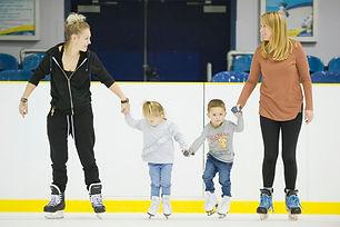 Toddlers ice skating