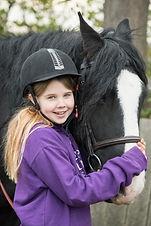 Child stroking ponies face
