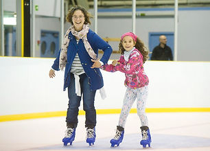 Mother and daughter ice skating
