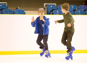 Boys ice skating at Lee Valley Ice Centre
