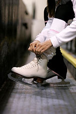 Lacing up ice skate