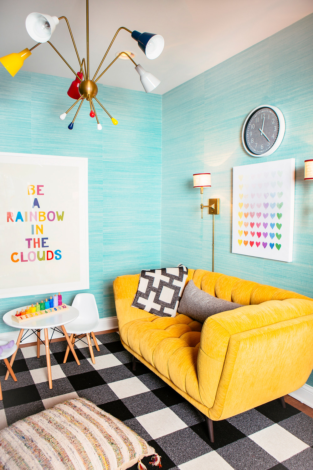 Yellow couch, black and white rug, buffalo check, rainbow art, grass-cloth walls, kids space, sputnik light