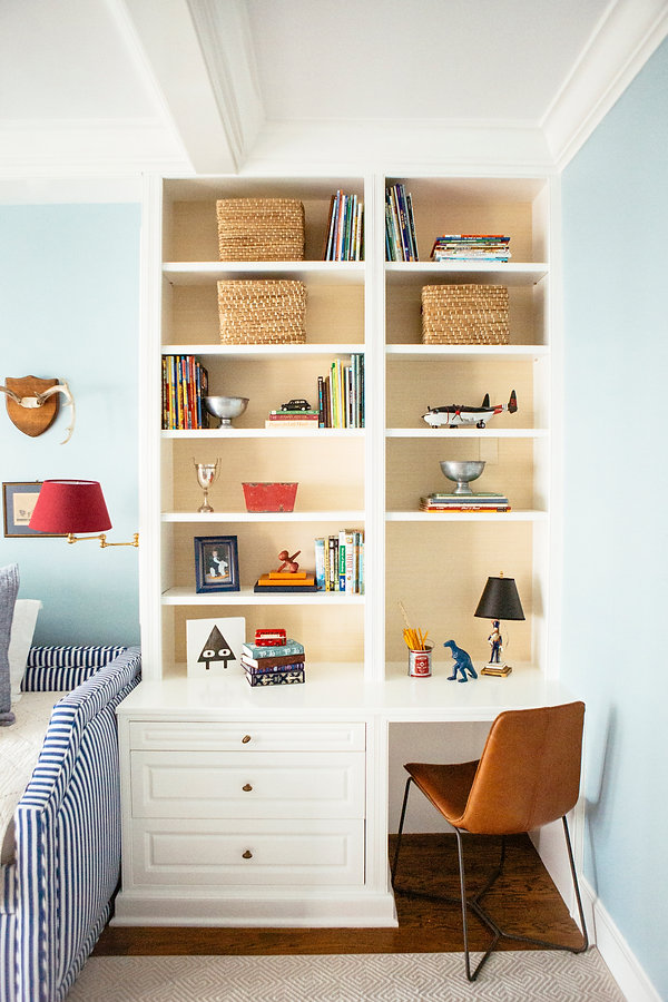 traditional boys room with built in desk blue and red