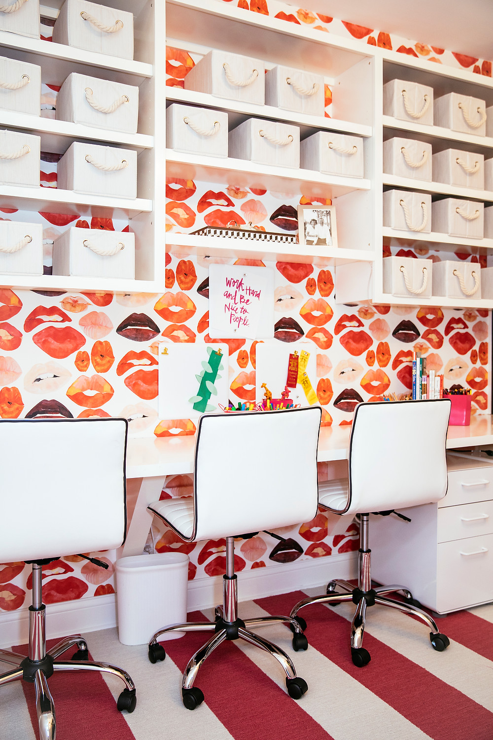 Kiss me wallpaper, lips wallpaper, kids office, storage boxes, exposed shelves, strip carpet, pink and white room