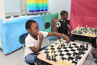 Indoor Chess Boys Playing Big Smile.JPG