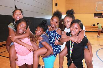 Indoor Gym Girls Smiling Piggy-Back.JPG