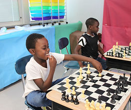 Indoor Chess Boys Playing Big Smile.JPG