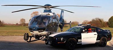 Photo accompagnée d'un hélicoptère de la Gendarmerie