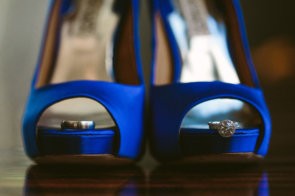 Bride's shoes with wedding bands