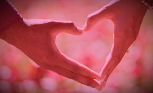 Two hands forming the shape of a heart