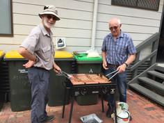 David & Peter presiding over the BBQ.JPG