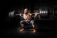 Strongman Doing Power Squat