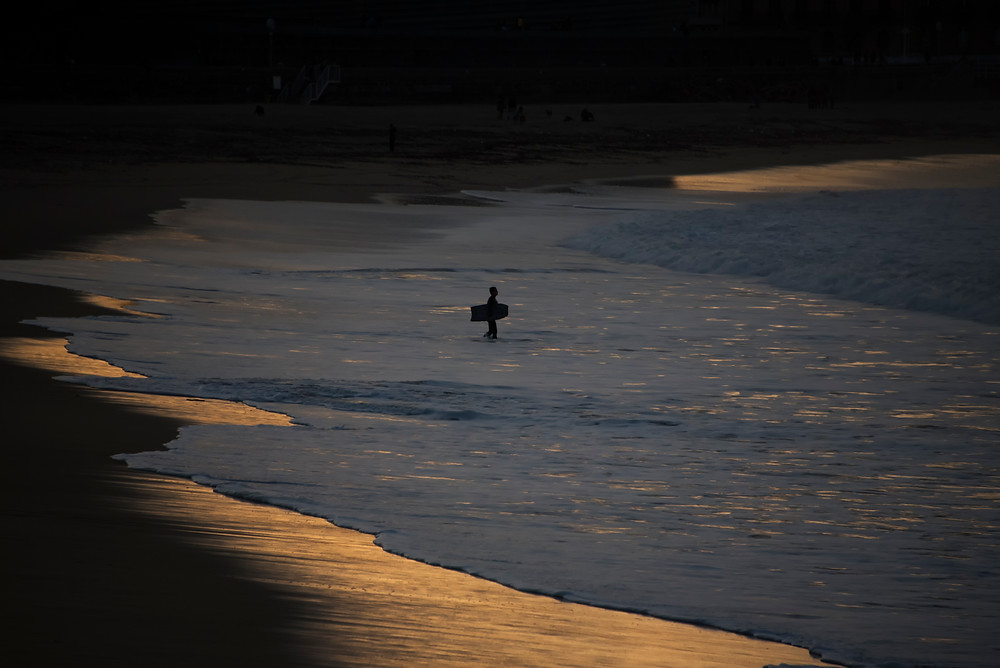 "Photographie d'art ""Bodyboarder at sunset""."