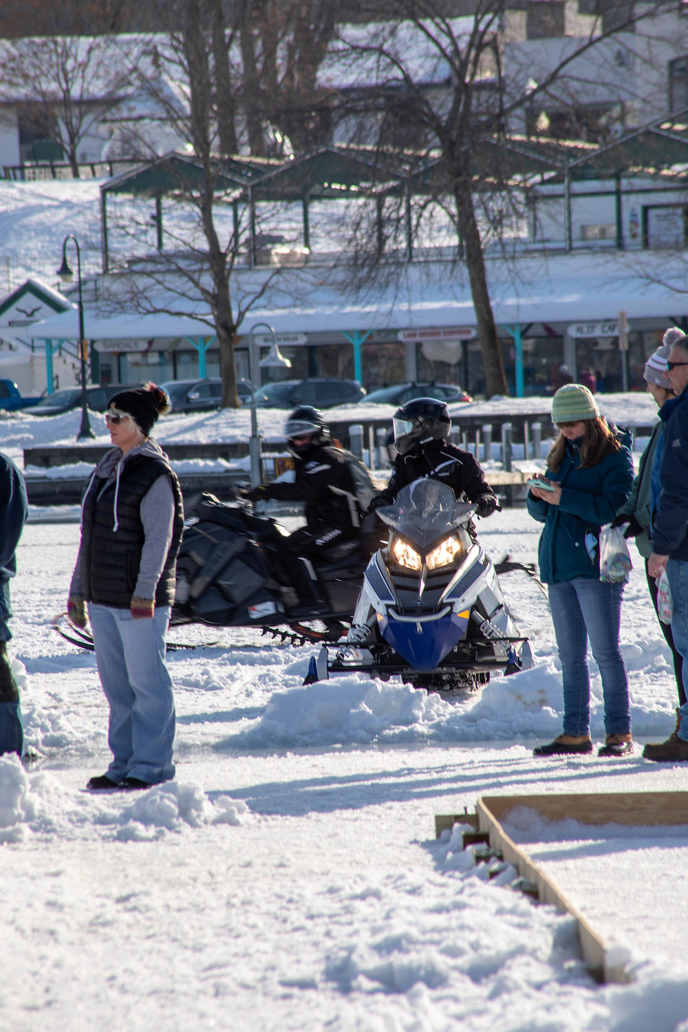 Snowmobilers taking a quick break to watch a game