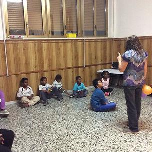 Mary and refugee kids.JPG