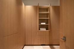 Walk-In Closet with Custom Cabinets