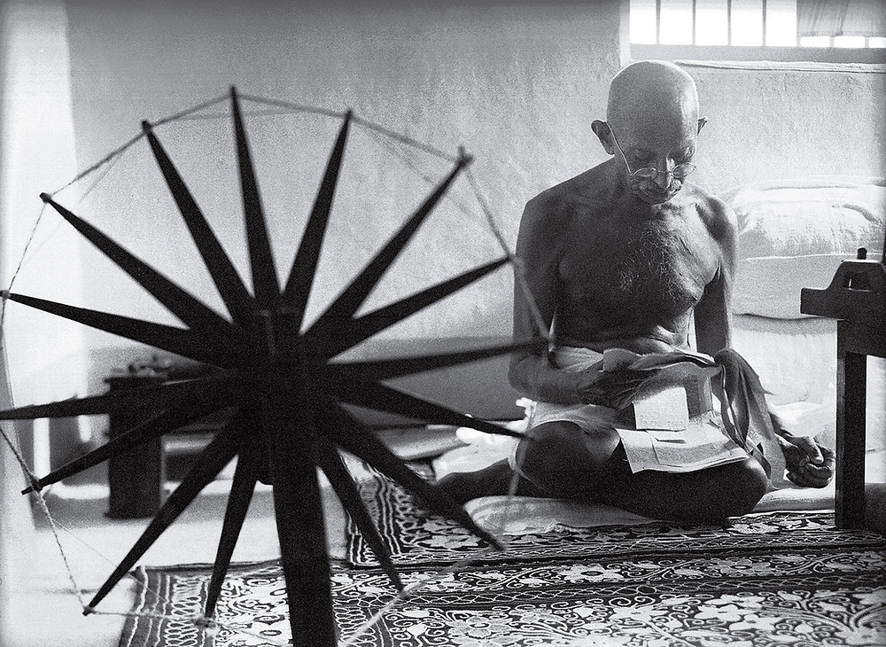 Margaret Bourke-White's famous photograph of Gandhi at the spinning wheel.  Part of the Qwiz5 series by Qwiz Quizbowl Camp, written to help quiz bowl teams power more tossups!