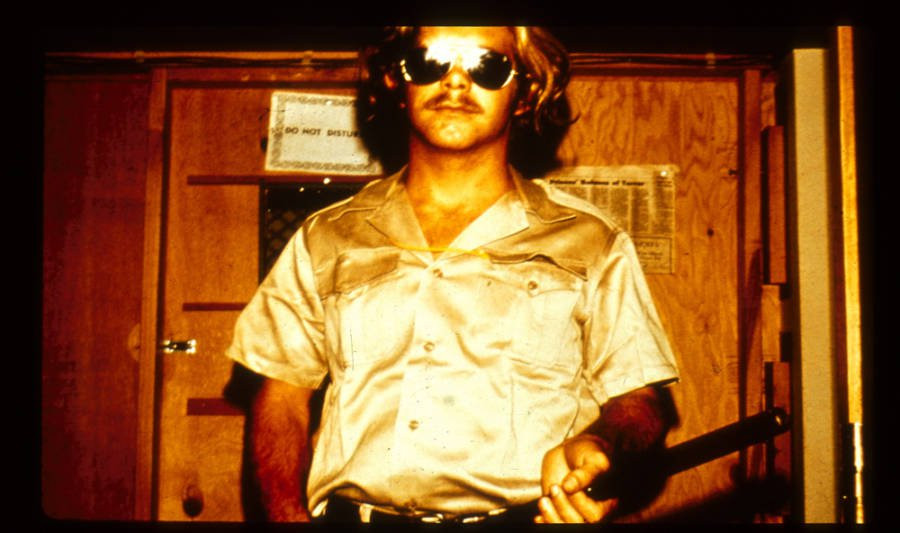 """A photograph of """"John Wayne"""" from the Stanford Prison Experiment. Part of the Qwiz5 series by Qwiz Quizbowl Camp, written to help quiz bowl teams power more tossups!"""