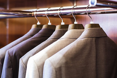 suits hanging in Wardrobe | Hugh Mann Development