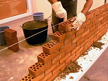 man building an interior brick wall