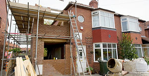 part finshed extension on side of house