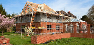 large new-build home with scaffolding