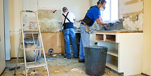 two builders working on kitchen conversion