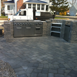 Gray patio design pavers with outdoor kitchen