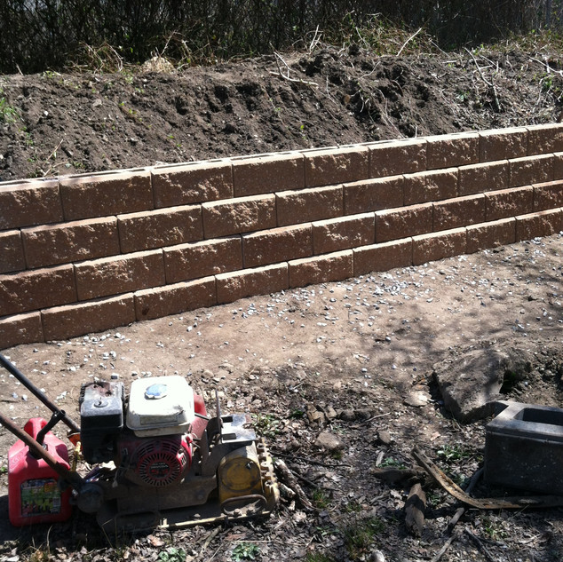 Stepped retaining wall being built