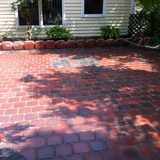 Red stone walkway with gray stone accent