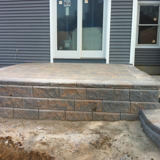 Raised walkway and steps with gray pavers.jpg