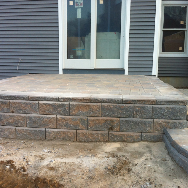 Raised walkway and steps with gray pavers.jpg