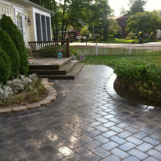 Gray paver walkway curved with landscaping