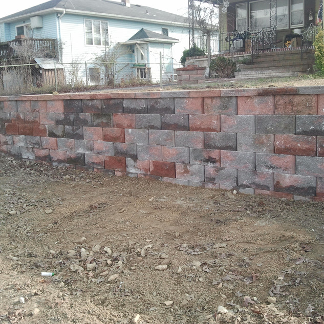 Red and gray stone retaining wall