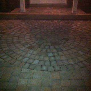 Circular entryway stone walkway hardscape
