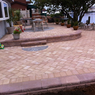 Red stone paved patio with gray accents