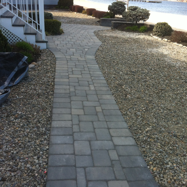 Gray stone walkway with hardscape surround
