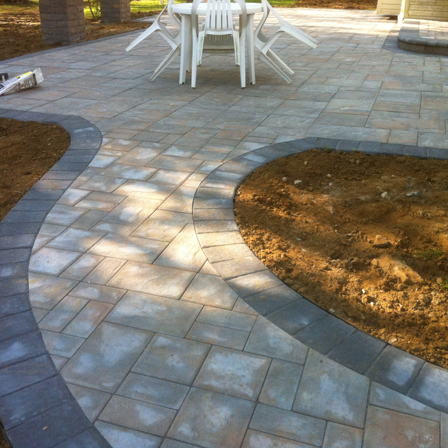 Curved gray stone walkway