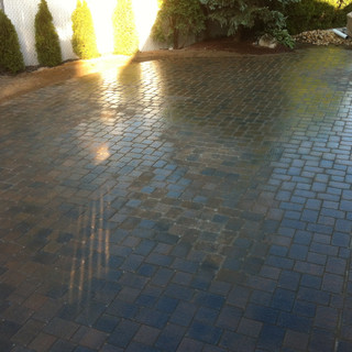 Light gray and dark gray stone walkway with landscaping