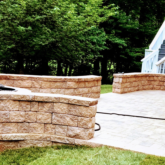 Outdoor firepit with wall seating