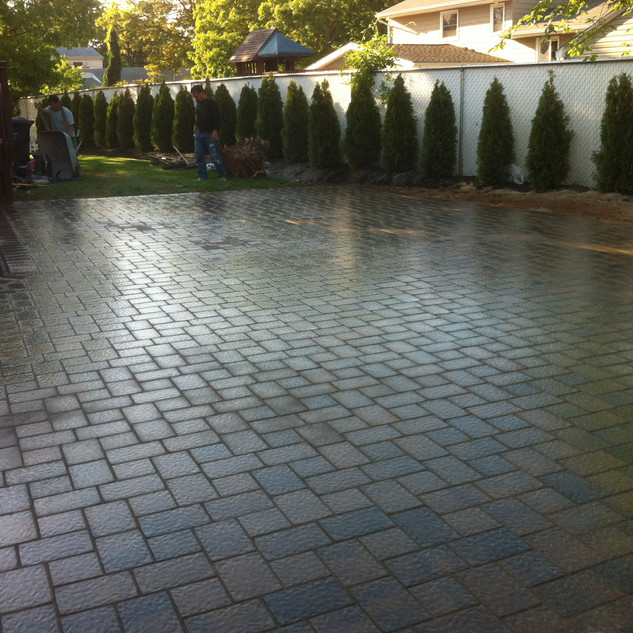 Stone patio with landscaping