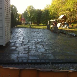 Dark gray patio with pavers