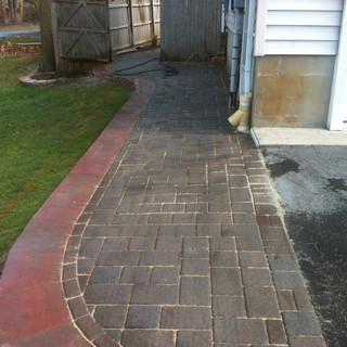 Gray stone walkway trimmed with red brick