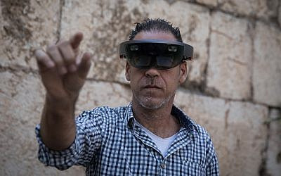 A man takes a look through Augmented Reality glasses at the Innovation Lab event at the Tower of David Museum in Jerusalem's Old City, October 17, 2017.