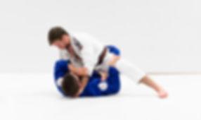 man doing knee on belly in brazilian jiu jitsu