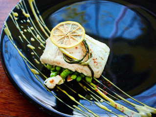 Olive Oil Poached Artic Cod With Spring Vegetable Fricassee, Ramps, Lemon Chips, & Vanilla Passi